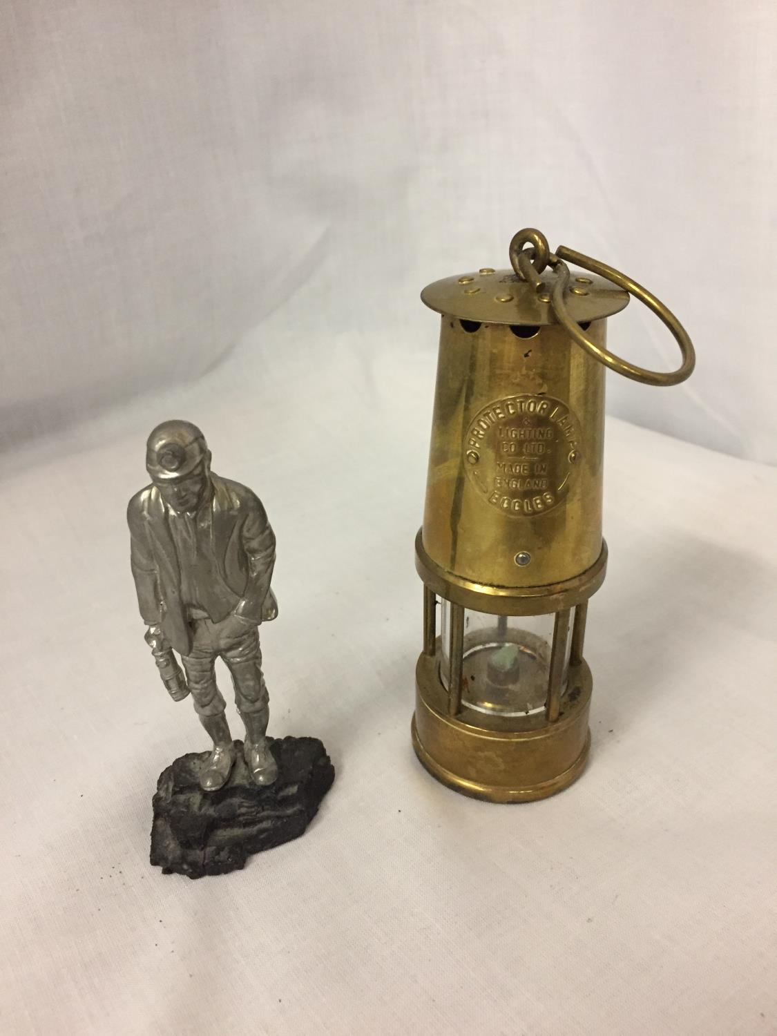 A BRASS MINATURE MINERS PROTECTION LAMP ECCLES AND A FIGURE OF A MINER