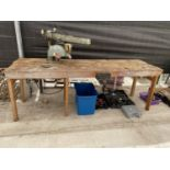 A LARGE INDUSTRIAL WORK BENCH WITH RECORD BENCH VICE AND DEWALT CIRCULAR SAW