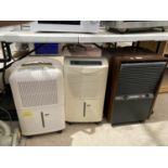 A GROUP OF THREE DEHUMIDIFIERS