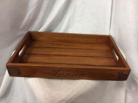 A LANSONS CHAMPAGNE WOODEN DRINKS TRAY. LENGTH 48CM