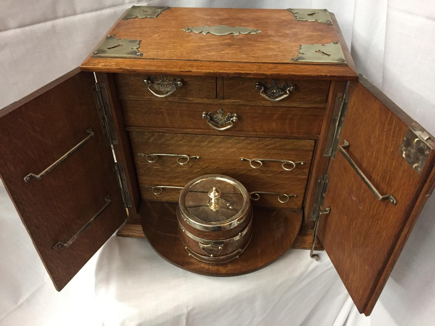 AN EDWARDIAN OAK SMOKING ROOM COMPENDIUM DATED 1921 HEIGHT 32CM - Image 2 of 4