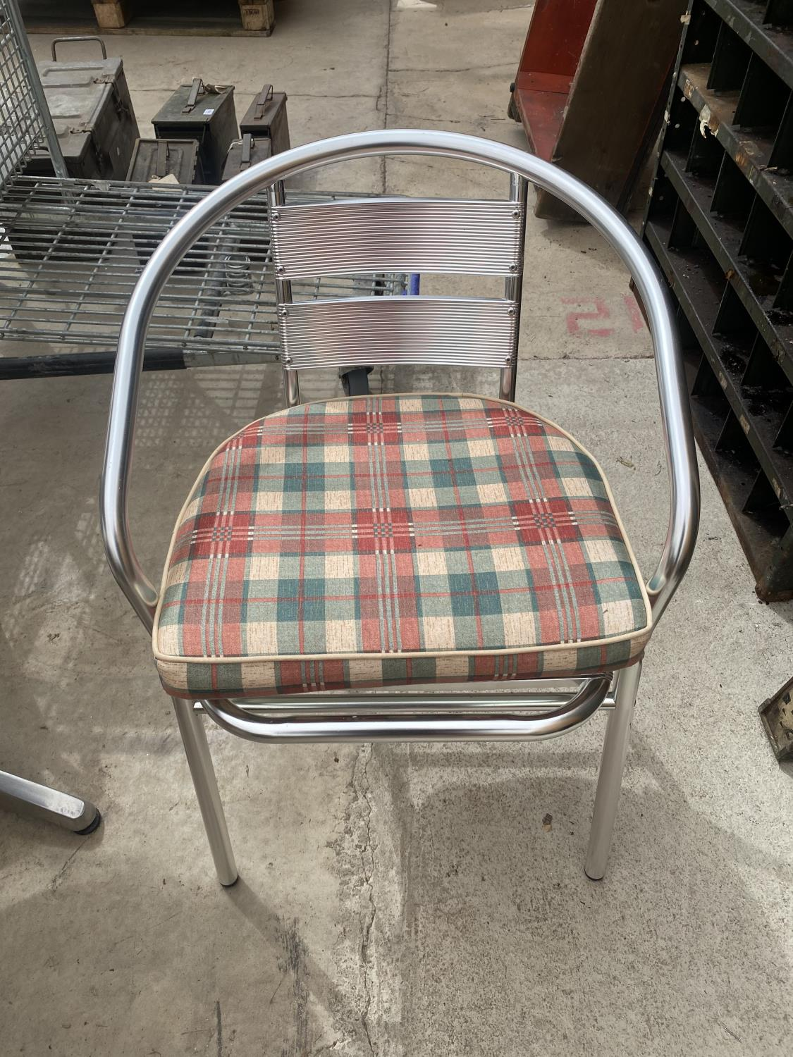 A STAINLESS STEEL BISTRO SET WITH ROUND TABLE AND FOUR CHAIRS - Image 3 of 5