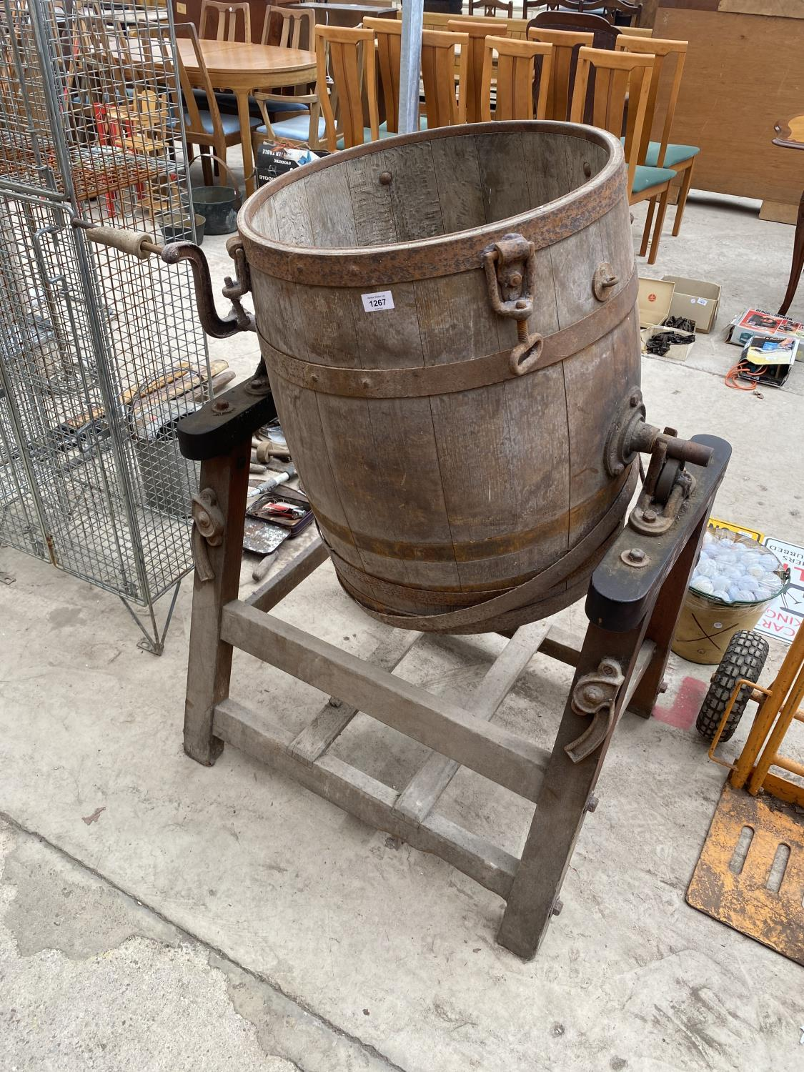 A LARGE VINTAGE BUTTER CHURN WITH STAND