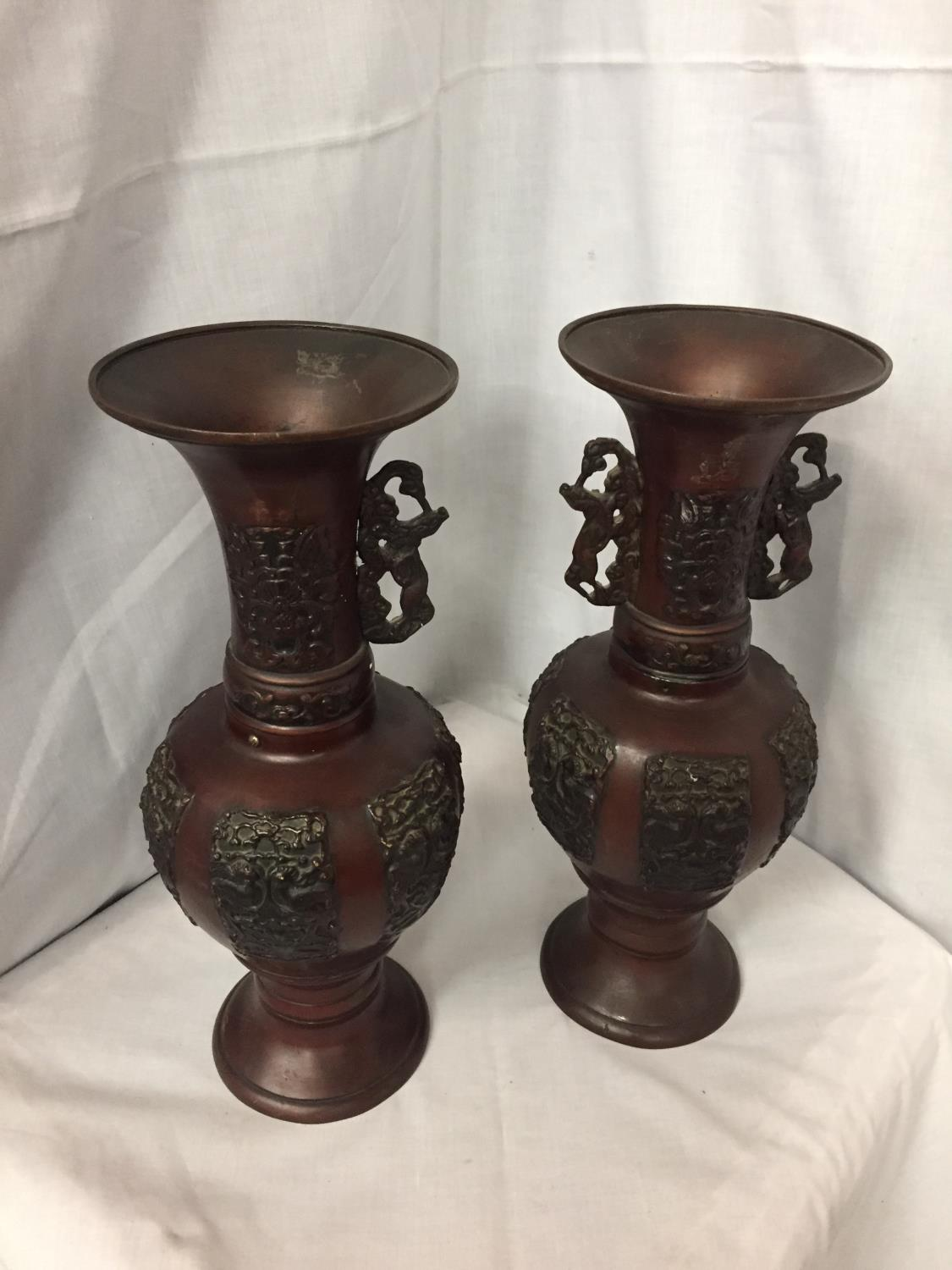 TWO DECORATIVE BRONZE URNS, ONE TOP NEEDS RE-AFFIXING, ONE MISSING HANDLE 38CM HIGH