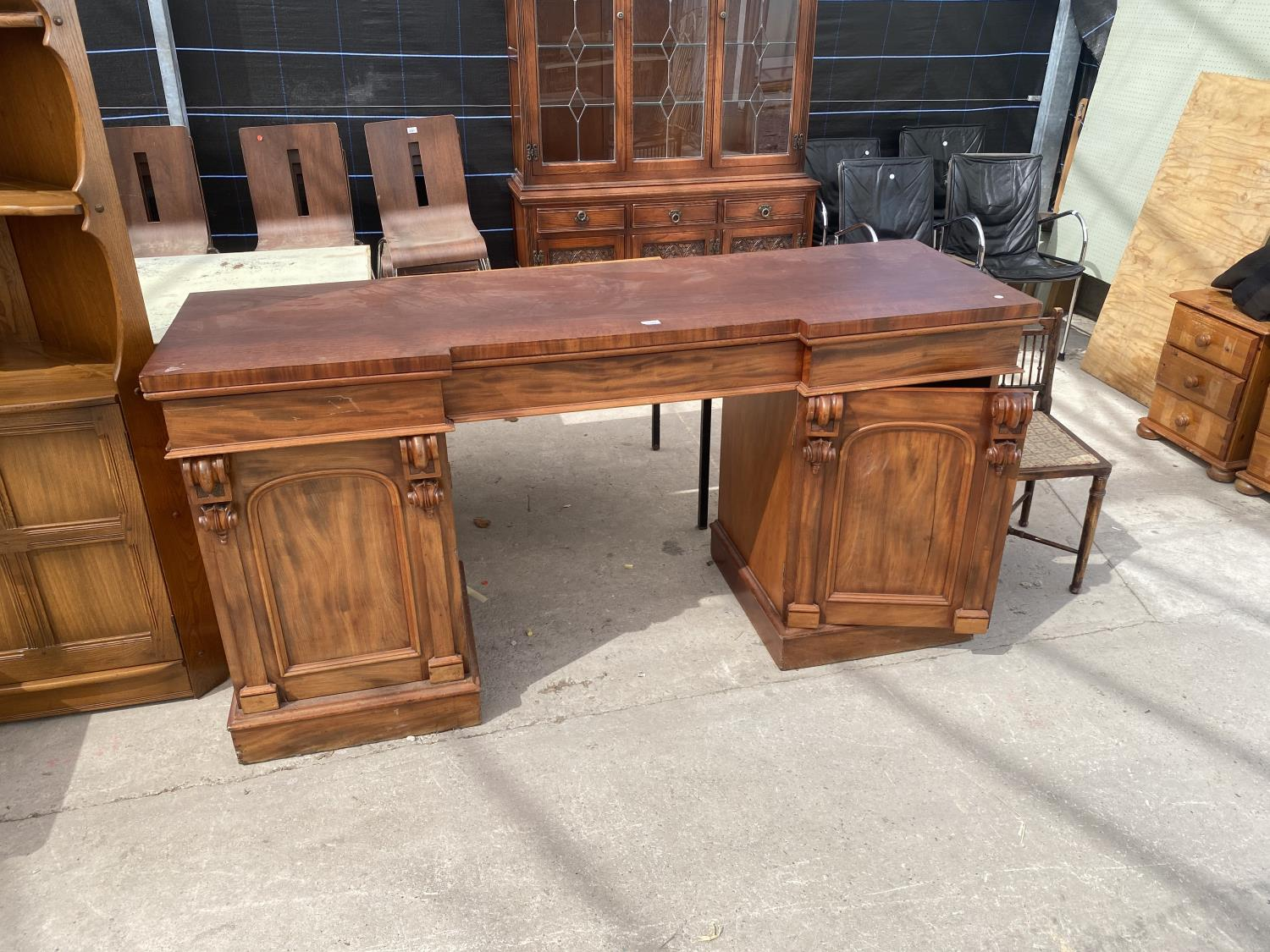 """A VICTORIAN INVERTED BREAKFRONT MAHOGANY DOUBLE PEDESTAL SIDEBOARD, 72"""" WIDE"""