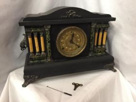 A VICTORIAN EIGHT DAY CATHEDRAL GONG EBONISED MANTEL CLOCK BY THE SESSIONS CLOCK CO.