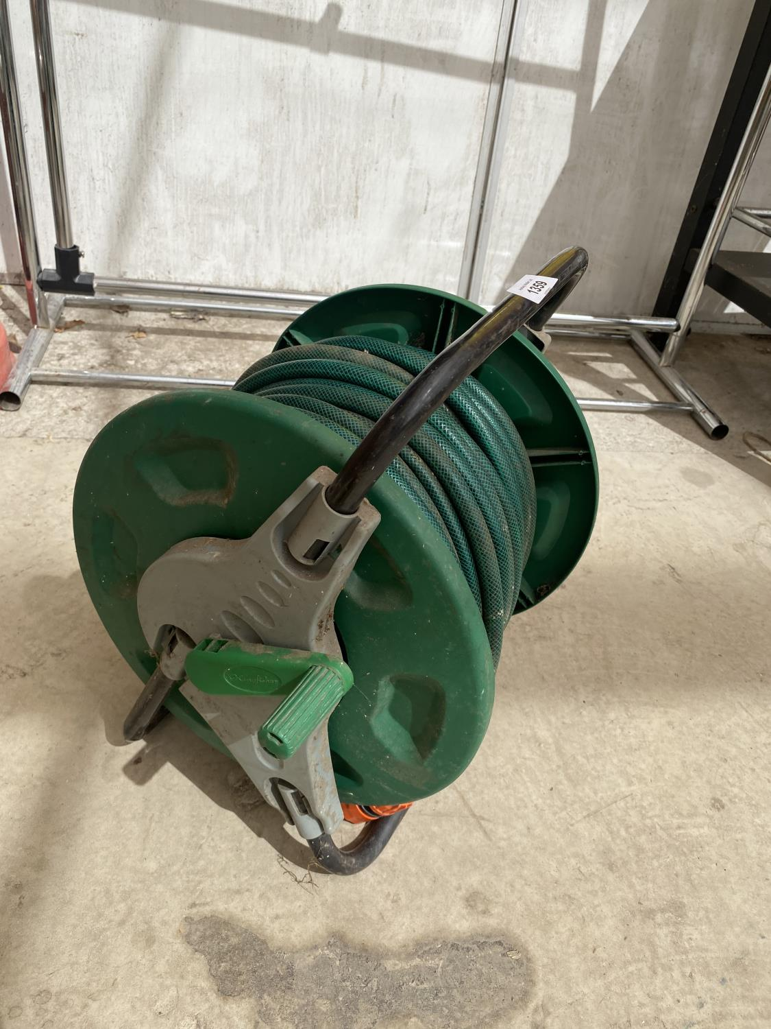 TWO GARDEN RAKES AND A HOSE REEL - Image 3 of 3