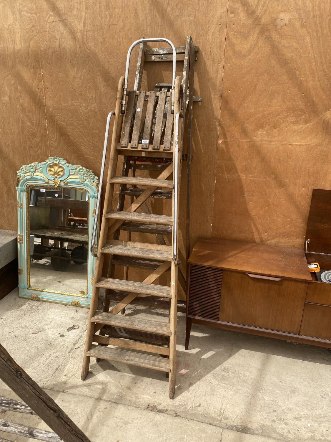 A VINTAGE 6 RUNG WOODEN STEP LADDER AND A VINTAGE 5 RUNG WOODEN STEP LADDER