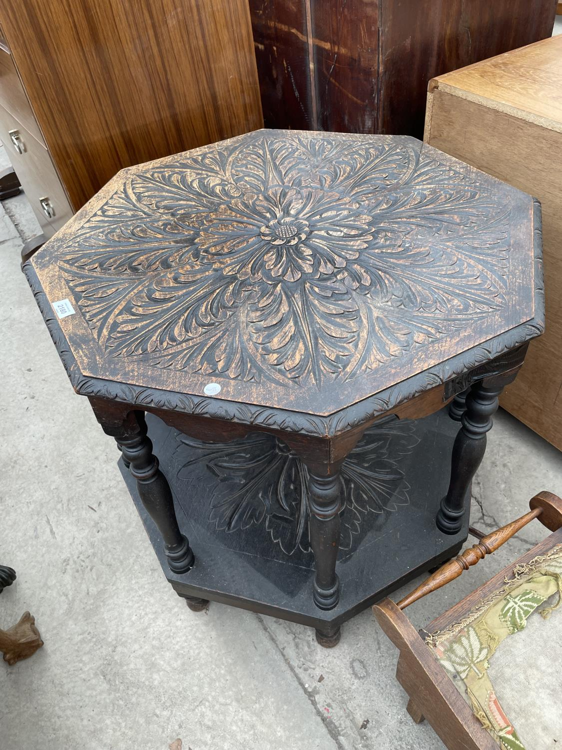 A HEAVILY CARVED VICTORIAN OAK OCTAGONAL TWO TIER OCCASIONAL TABLE