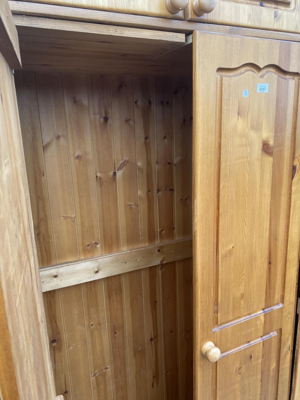 A MODERN PINE THREE DOOR WARDROBE - Image 5 of 5