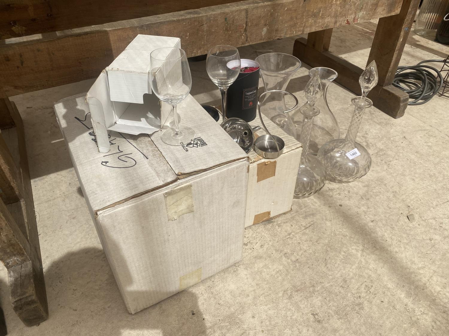 AN ASSORTMENT OF GLASS ITEMS TO INCLUDE VASES AND TWO DECANTORS ETC