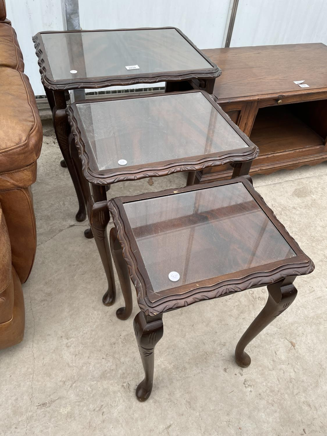 A REPRODUCTION NEST OF THREE TABLES ON CABRIOLE LEGS