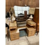 AN OAK ART DECO STYLE DRESSING TABLE WITH UNFRAMED MIRROR, SIX DRAWERS AND TWIN LAMPS