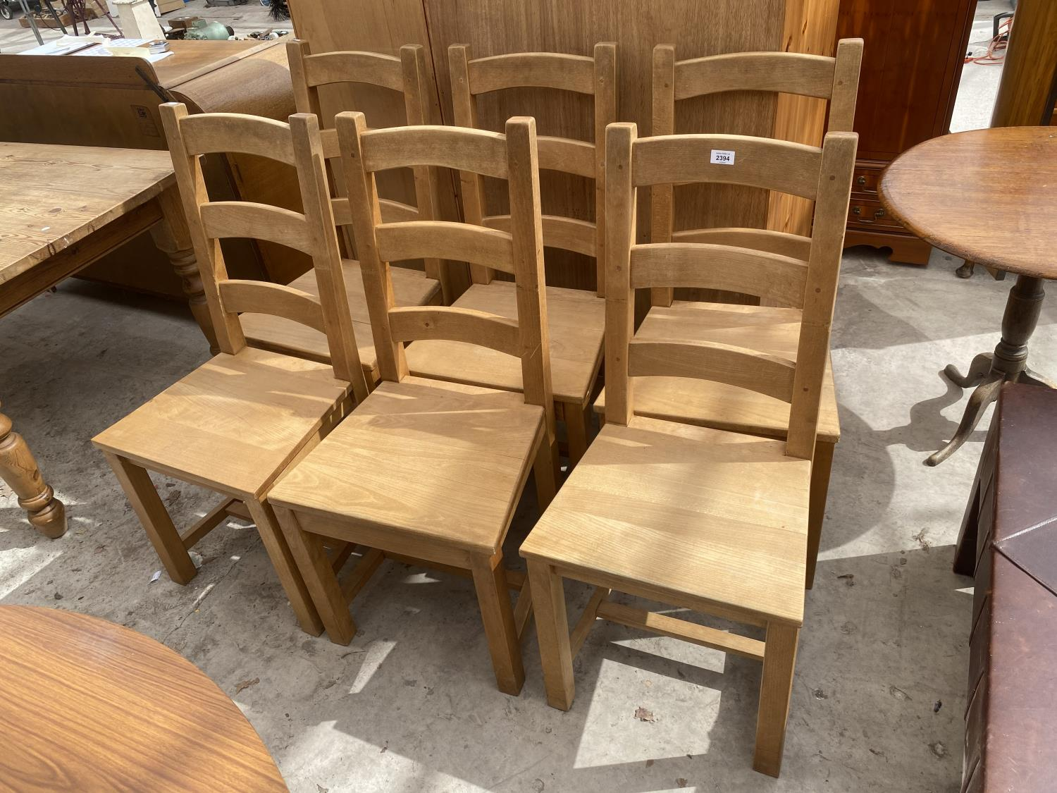 A SET OF SIX PINE LADDER-BACK DINING CHAIRS