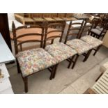 A SET OF FOUR SPANISH STYLE DINING CHAIRS WITH TURNED LEGS AND UPRIGHTS