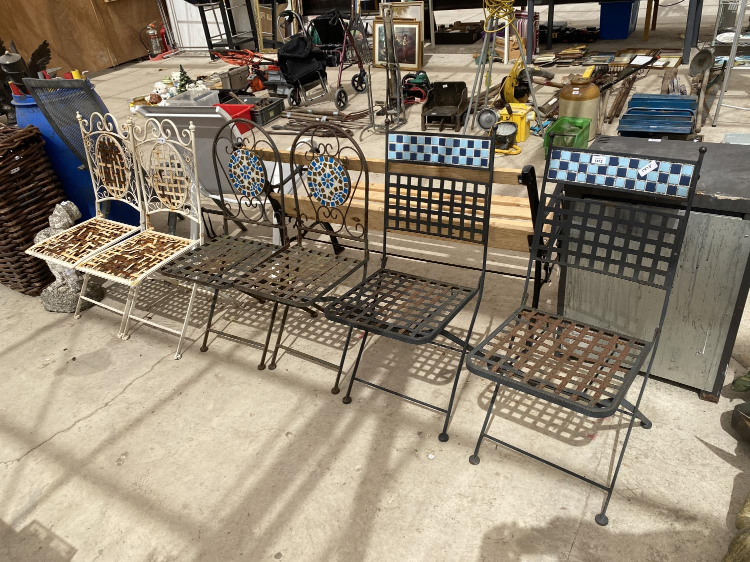A GROUP OF THREE PAIRS OF FOLDING GARDEN CHAIRS