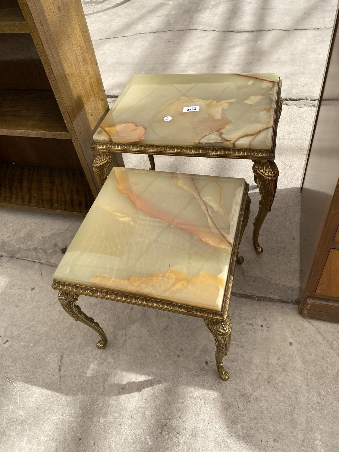 A NEST OF TWO ONYX TABLES