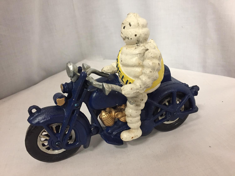 A CAST MICHELIN MAN ON A MOTOR BIKE - Image 2 of 3