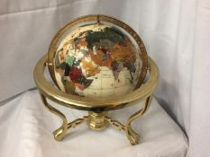 A GEM STONE AND PEARLISED GLOBE ON BRASS STAND 32CM HIGH