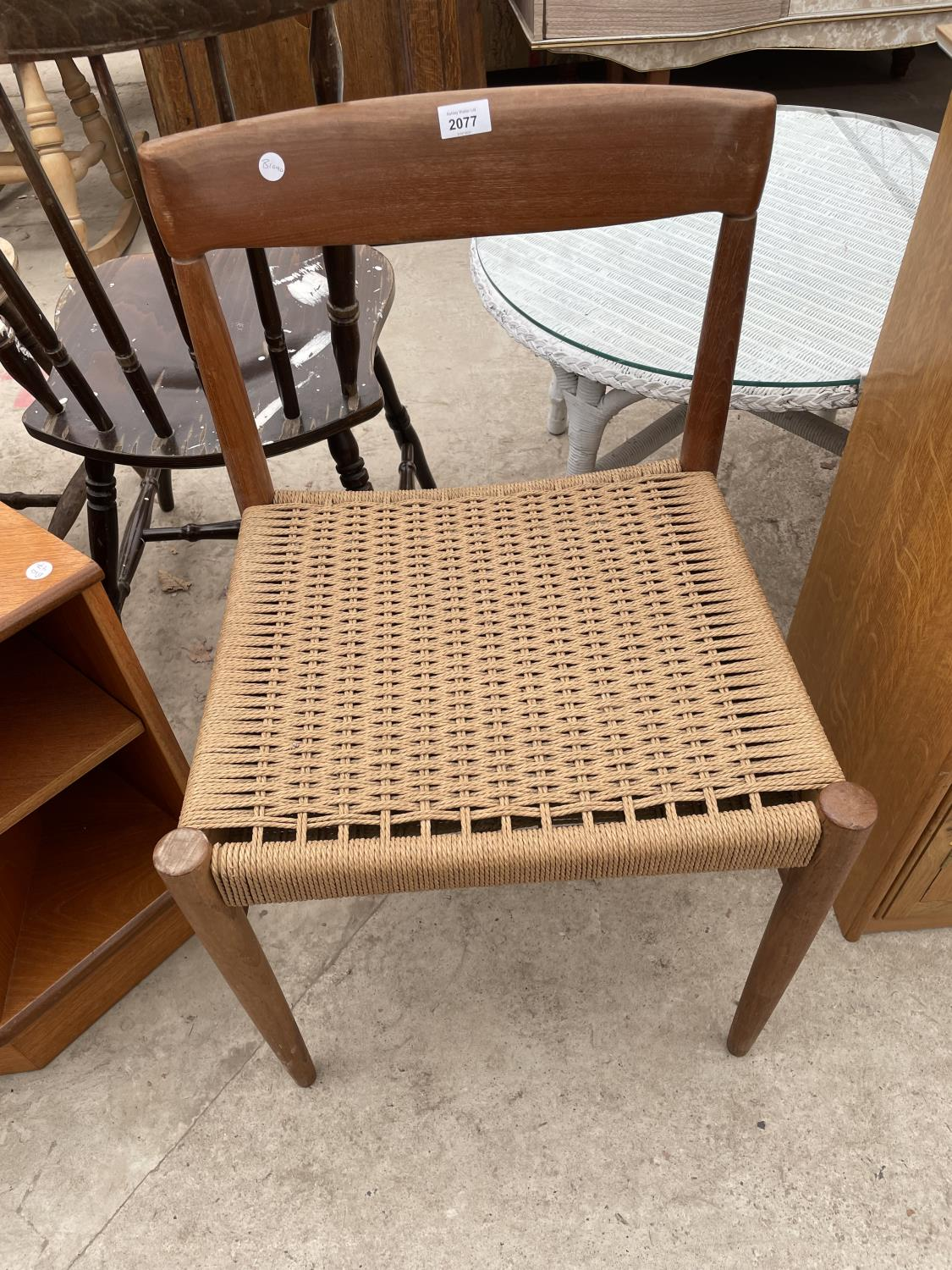 A RETRO TEAK SINGLE DINING CHAIR WITH RATTAN SEAT