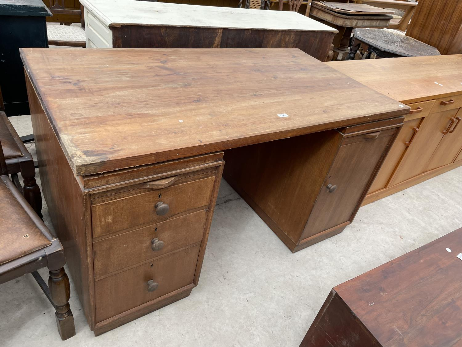 """A MID 20TH CENTURY TWIN PEDESTAL DESK ENCLOSING DRAWERS AND SLIDES WITH PINE TOP, 54X29.5"""""""