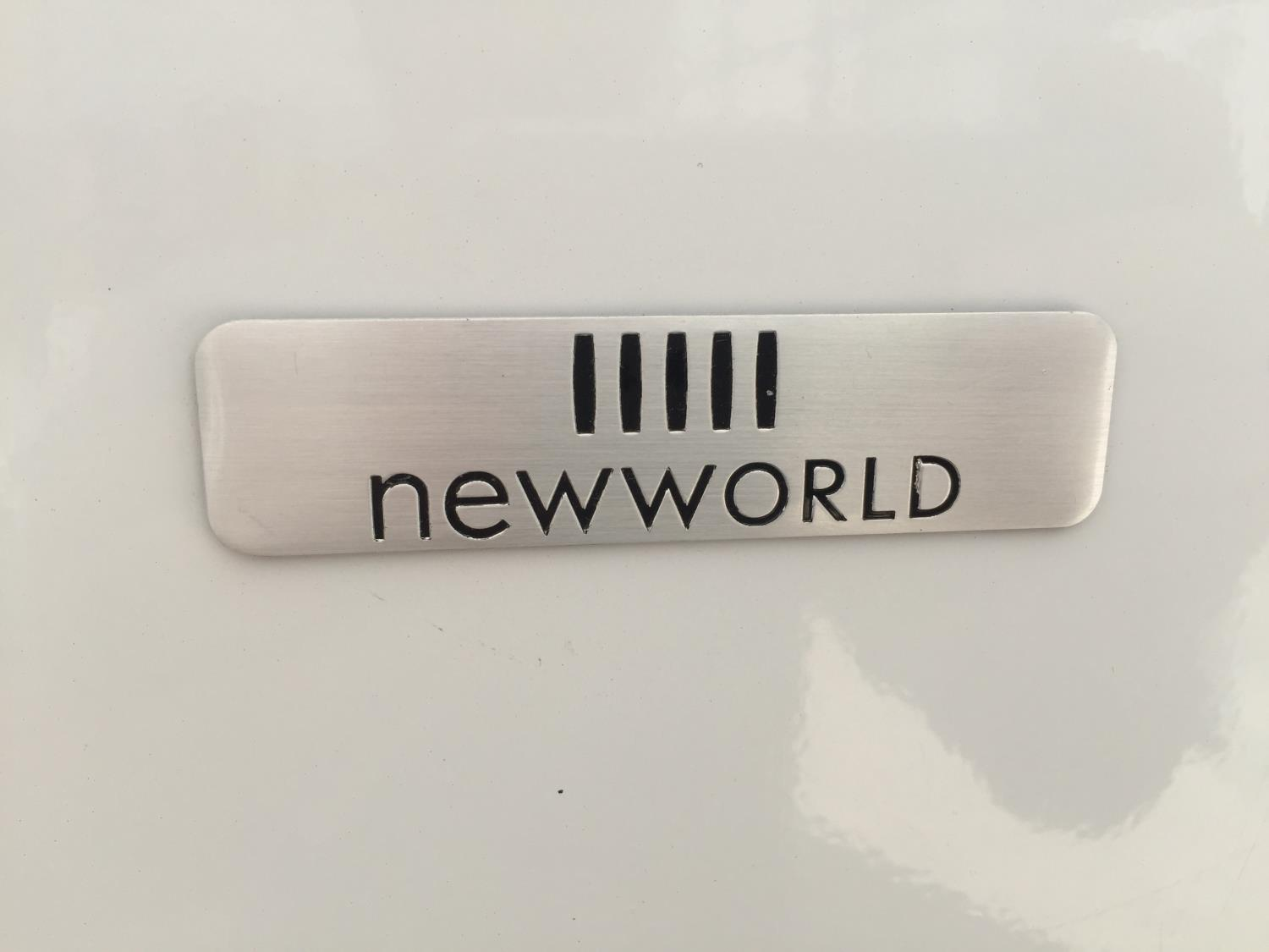 A WHITE NEWWORLD UPRIGHT FRIDGE FREEZER BELIEVED IN WORKING ORDER BUT NO WARRANTY - Image 3 of 4