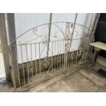 A PAIR OF WHITE PAINTED WROUGHT IRON GATES