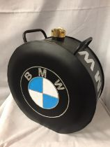 A BLACK BMW PETROL CAN WITH A BRASS TOP