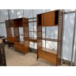 A STAPLES LADDERAX UNIT FURNITURE FOUR SECTION WALL UNIT ENCLOSING CUPBOARDS, SHELVES AND DRAWERS
