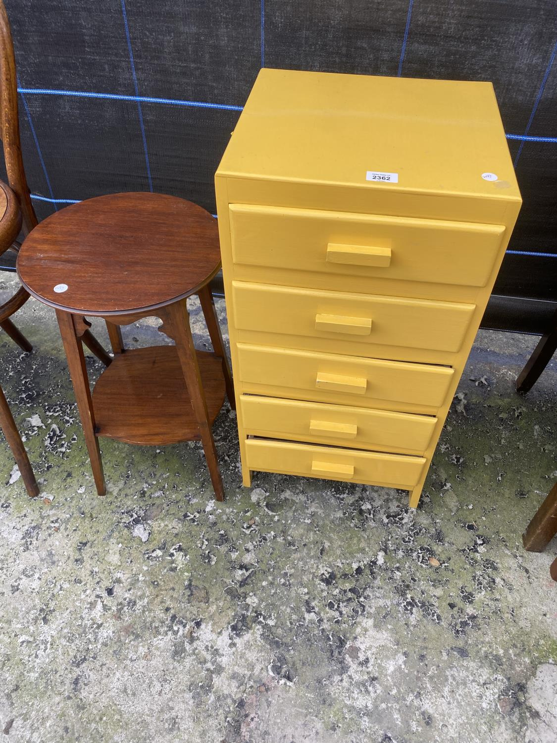 A YELLOW PAINTED CHEST OF FIVE DRAWERS AND AN EDWARDIAN TWO TIER OCCASIONAL TABLE