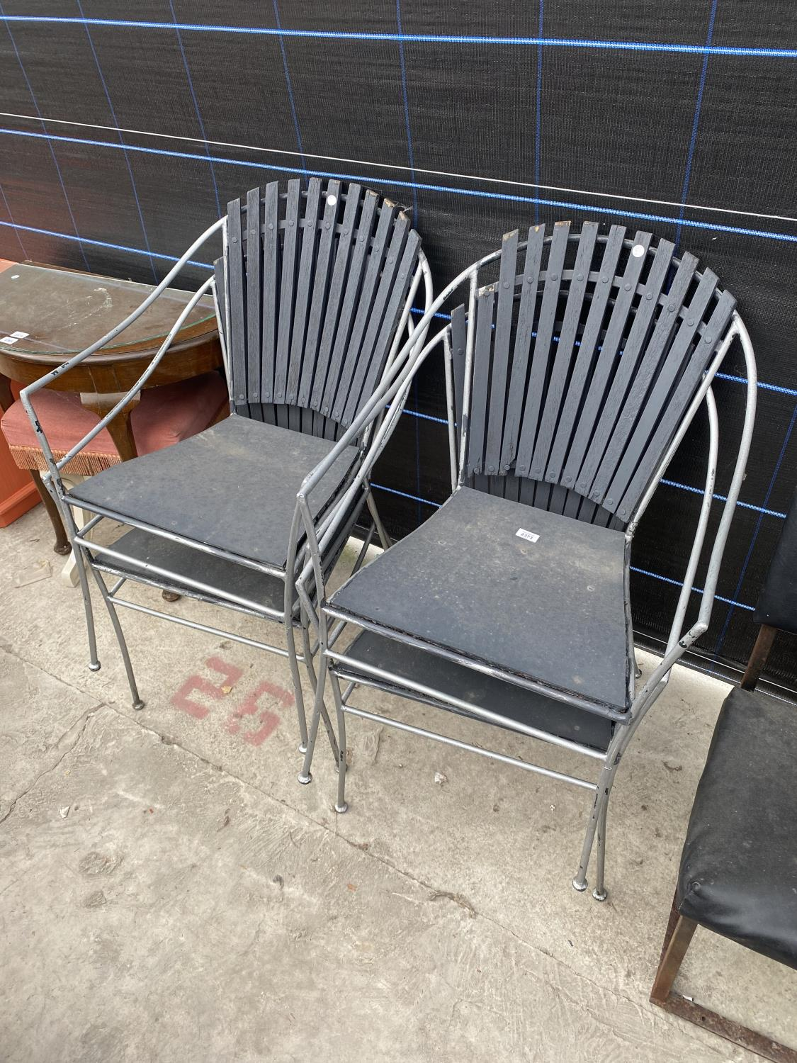FOUR METAL FRAMED PATIO CHAIRS