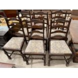 A SET OF SIX OAK REPRODUCTION LADDERBACK DINING CHAIRS ON TURNED LEGS