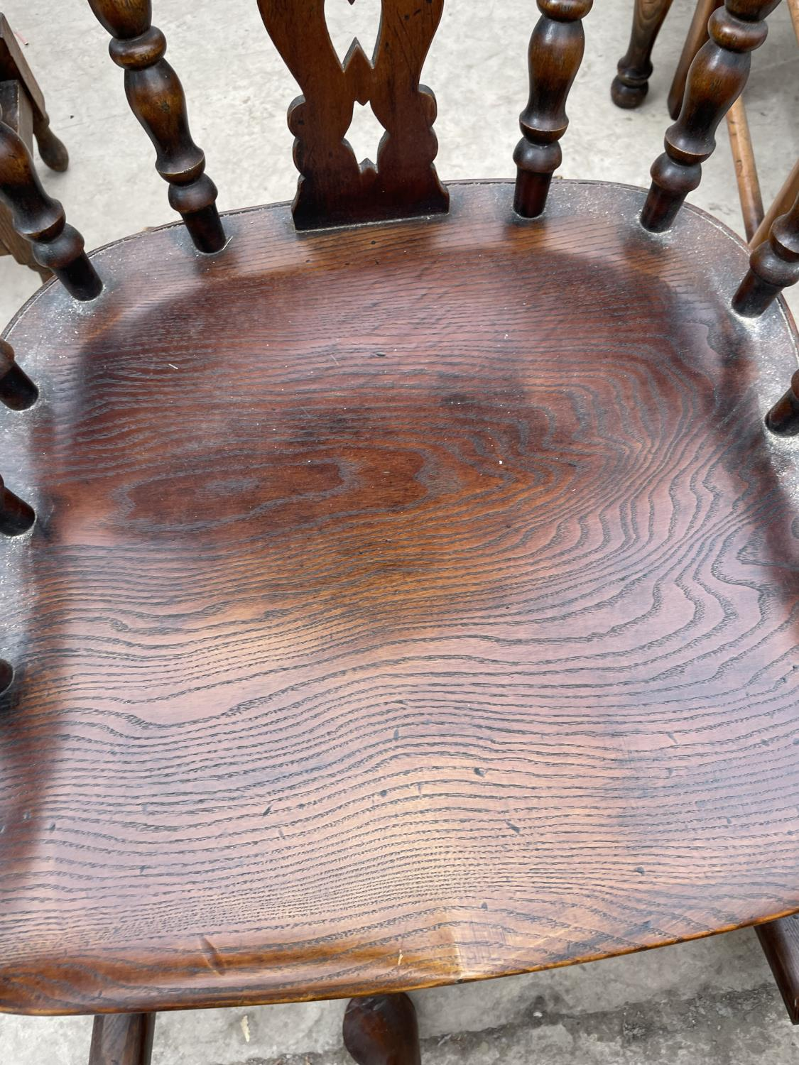 A REPRODUCTION WINDSOR ROCKING CHAIR WITH TURNED UPRIGHTS, BEARING LABEL 'R.E.FORSTER, WARRINGTON' - Image 5 of 5