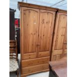 """A MODERN TWO DOOR WARDROBE WITH TWO DRAWERS TO THE BASE, 39.5"""" WIDE, BEARING RELYON LABEL"""