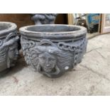 A PAIR OF STONE EFFECT PLANTERS AND A BIRD BATH