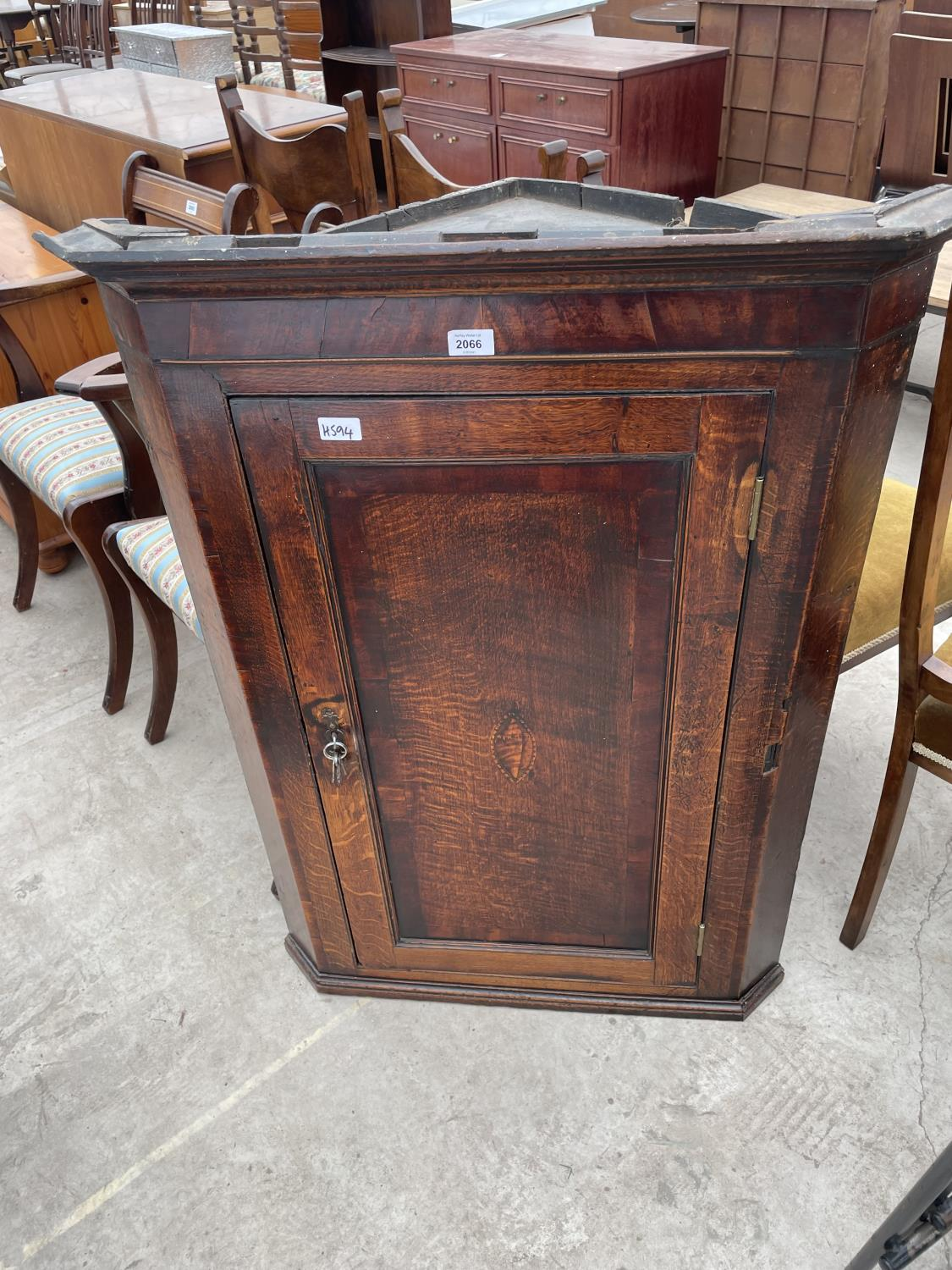 """A GEORGE III OAK CROSSBANDED SHELL INLAID CORNER CUPBOARD WITH SHAPED INTERIOR SHELVES, 31"""" WIDE"""