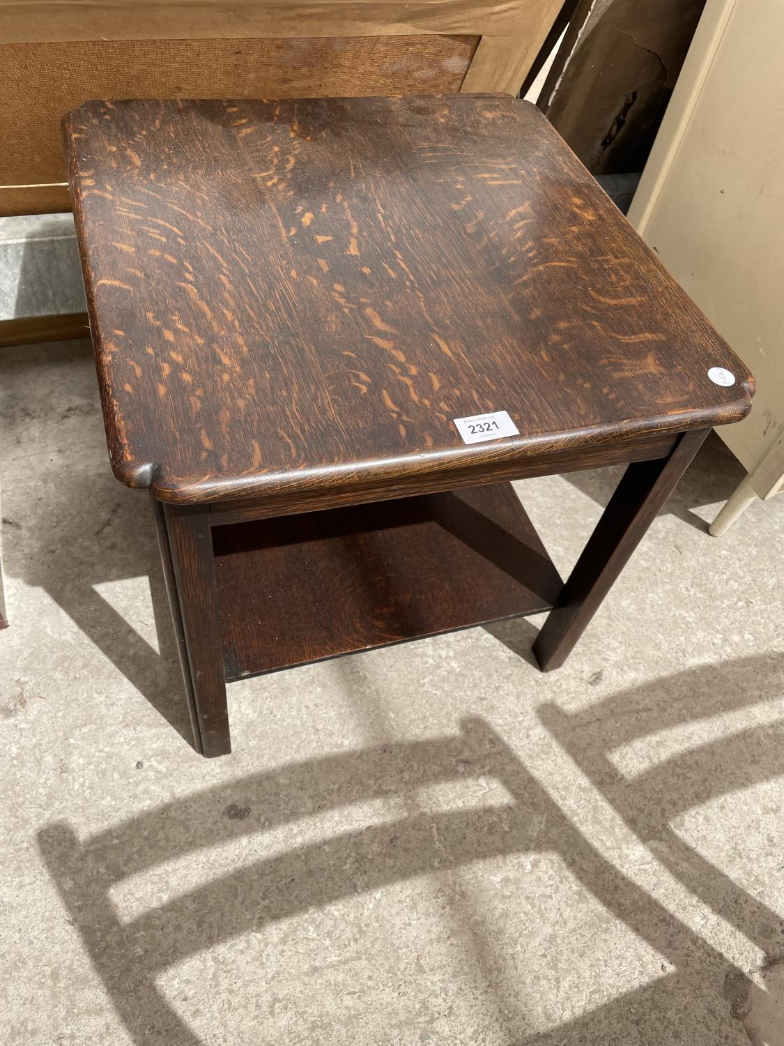 AN OAK OCCASIONAL TABLE WITH LOWER SHELF