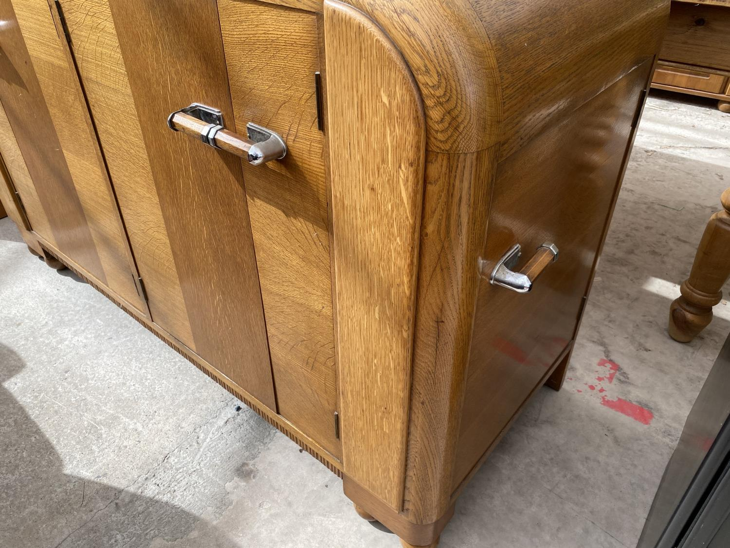 AN OAK E-GOMME SIDEBOARD DATED 1939 ENCLOSING CURVED END CUPBOARDS, TWO PAIRS OF CUPBOARDS WITH FOUR - Image 3 of 9