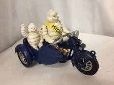 A CAST MICHELIN MAN ON A MOTOR BIKE
