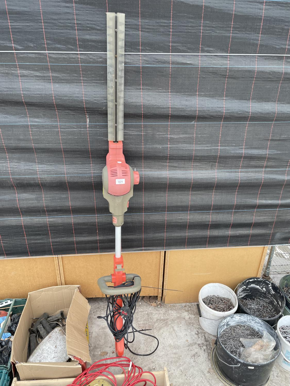 AN ELECTRIC LONG REACH HEDGE TRIMMER