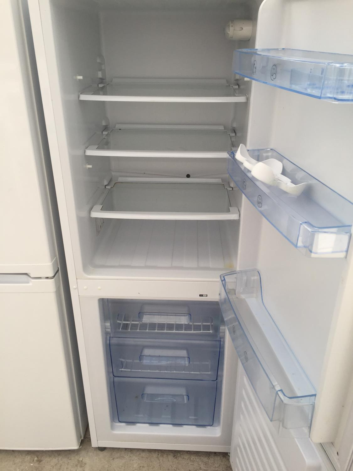 A WHITE NEWWORLD UPRIGHT FRIDGE FREEZER BELIEVED IN WORKING ORDER BUT NO WARRANTY - Image 4 of 4