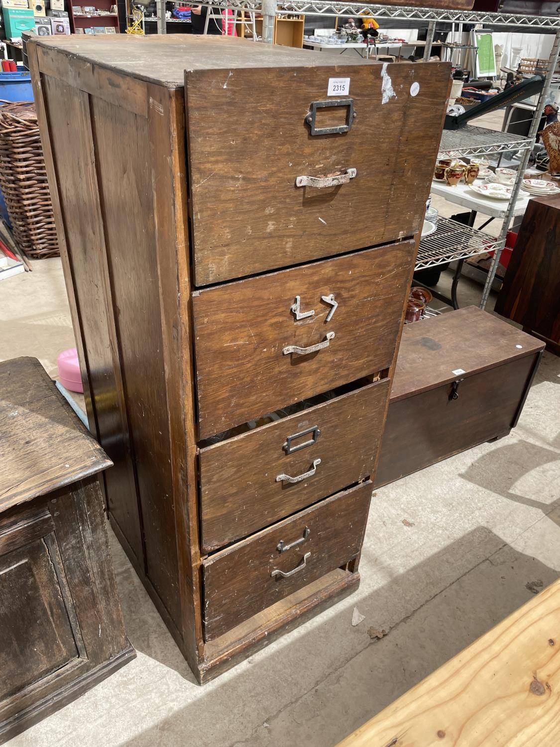 A MID CENTURY OAK FOUR DRAWER FILING CABINET