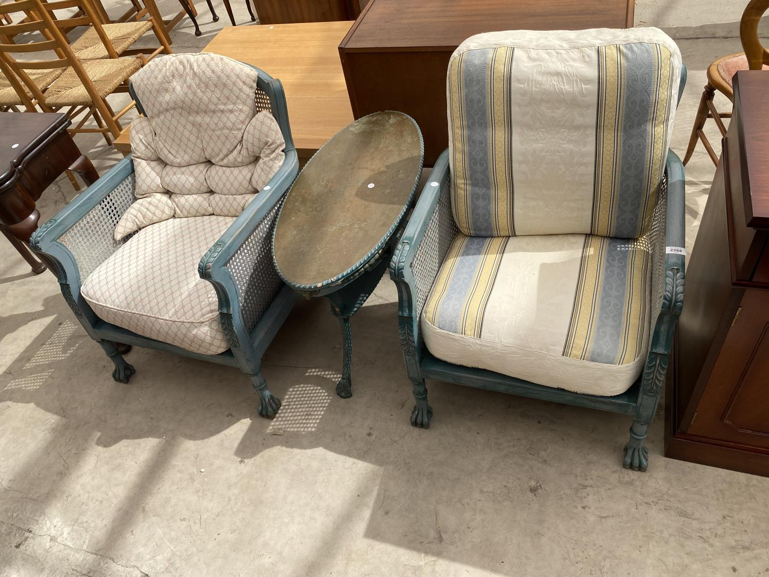 A PAIR OF EARLY 20TH CENTURY BERGERE FIRESIDE CHAIRS ON CLAW FEET, HAVING SHABBY CHIC PAINTING,