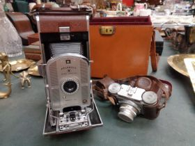A VINTAGE POLAROID CAMERA WITH CASE AND A FURTHER PAXETTE CAMERA