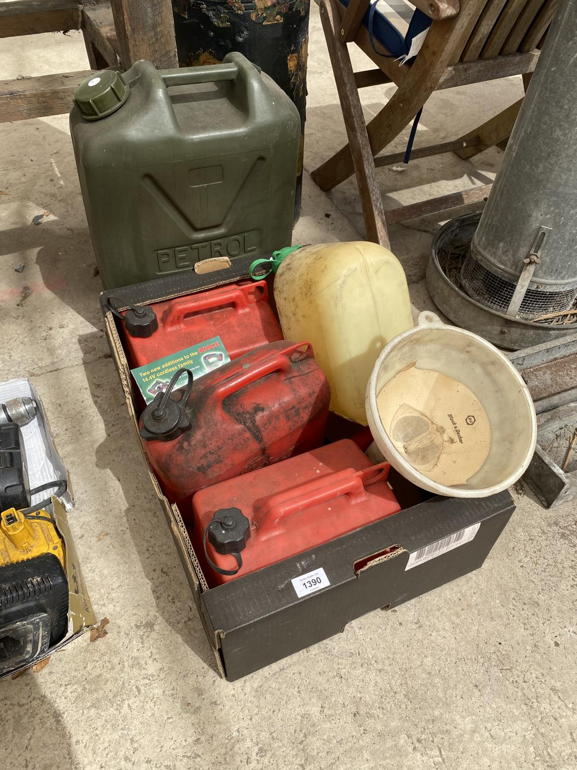 AN ASSORTMENT OF PLASTIC FUEL CANS