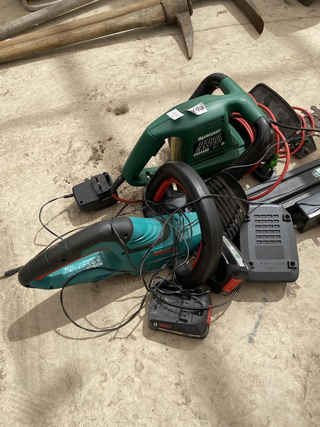 TWO ELECTRIC HEDGE TRIMMERS AND AN ASSORTMENT OF BATTERIES - Image 2 of 3