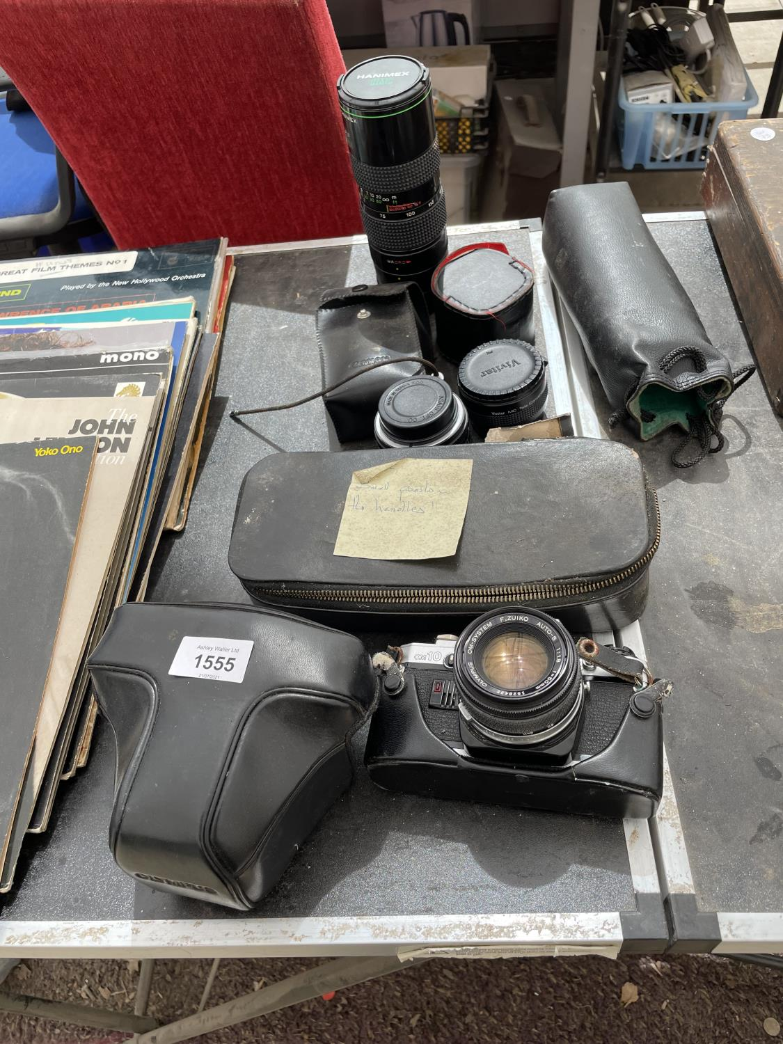 AN ASSORTMENT OF CAMERA EQUIPMENT TO INCLUDE HANIMEX AUTOZOOM LENS, OLYMPUS C10 CAMERA AND VIVITAR - Image 2 of 4