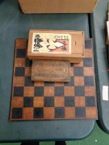 A VINTAGE WOODEN CHESS BOARD WITH A SET OF STAUNTON STYLE CHESS PIECES IN ORIGINAL BOX AND A FURTHER