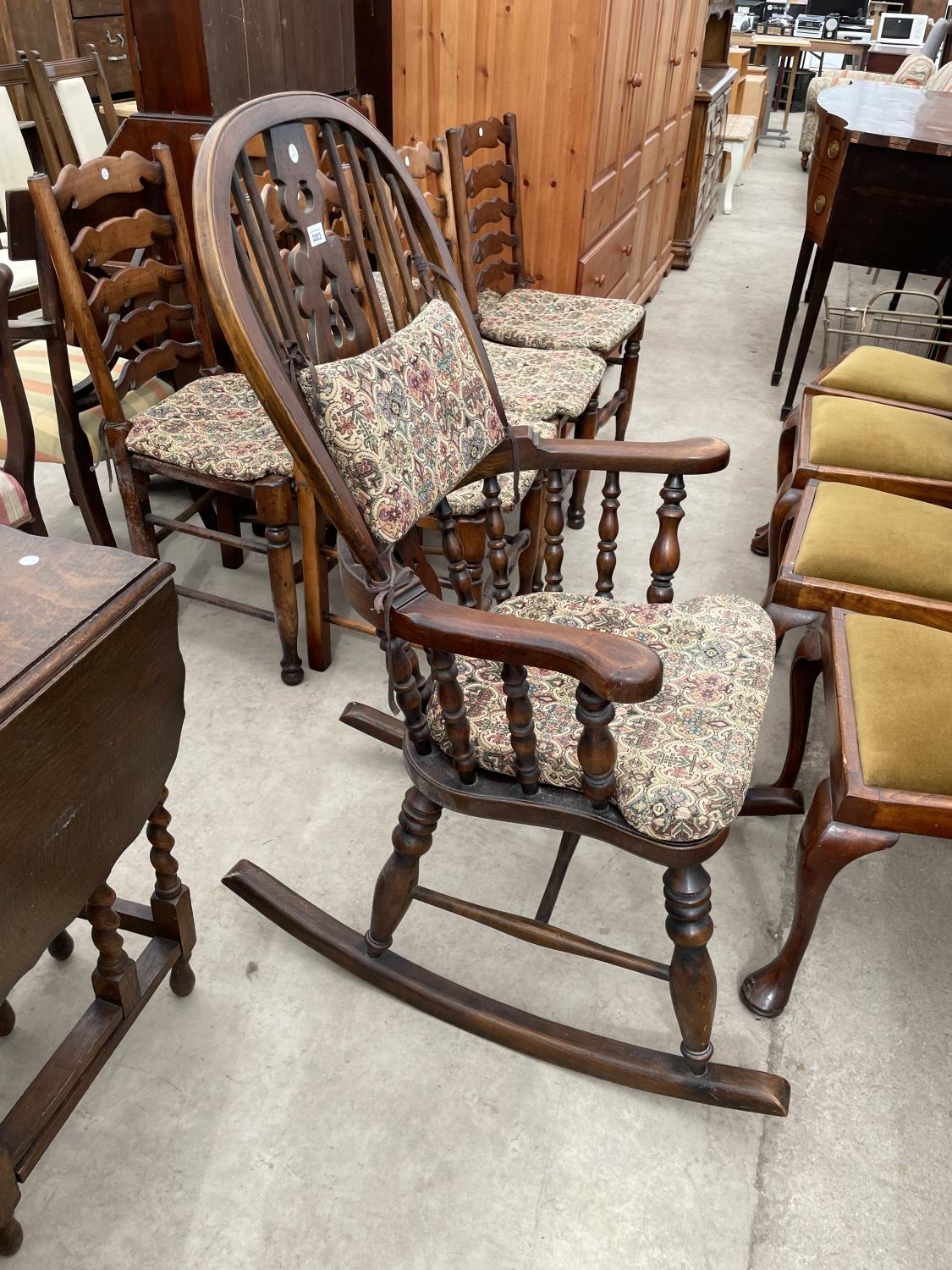 A REPRODUCTION WINDSOR ROCKING CHAIR WITH TURNED UPRIGHTS, BEARING LABEL 'R.E.FORSTER, WARRINGTON' - Image 4 of 5