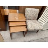 A NEST OF THREE RETRO TEAK TABLES AND FLORAL BEDROOM CHAIR